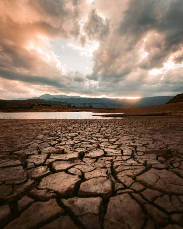 (image of a cloudy day or some dry, cracked earth).jfif
